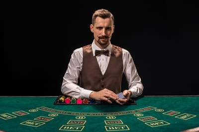 Croupier at the Blackjack Table