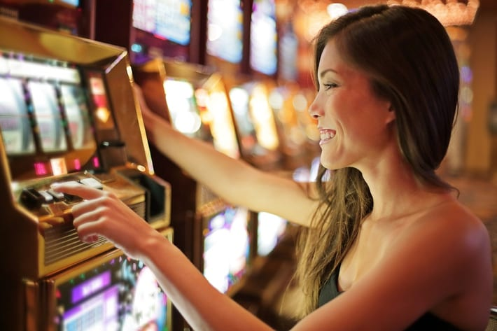 Woman playing low stakes slots