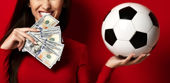 Woman with soccer ball and cash