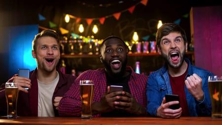 Pub friends watching game
