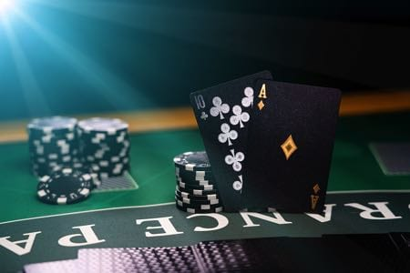 Blackjack table with black cards