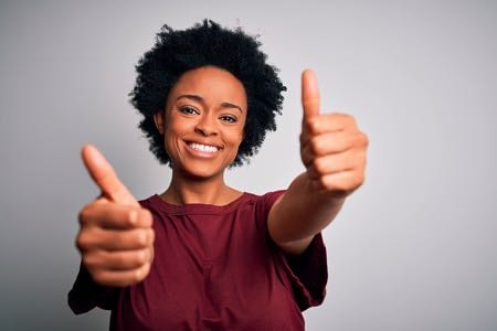 Positive woman with two thumbs up