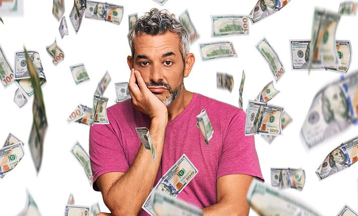 Man with lots of money looking annoyed