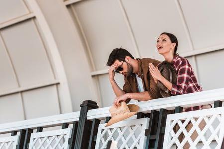 Upset man & woman watching races