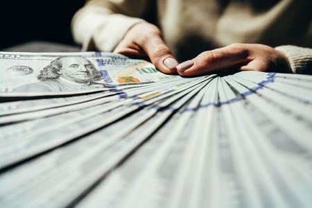 Fanning out $100 bills