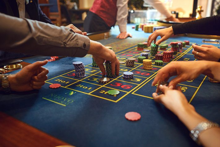 Players Wagering at Roulette Table