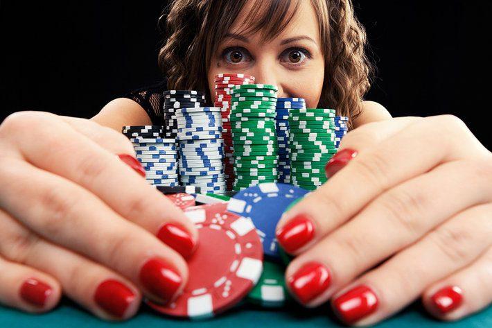 Woman Hoarding Poker Chips